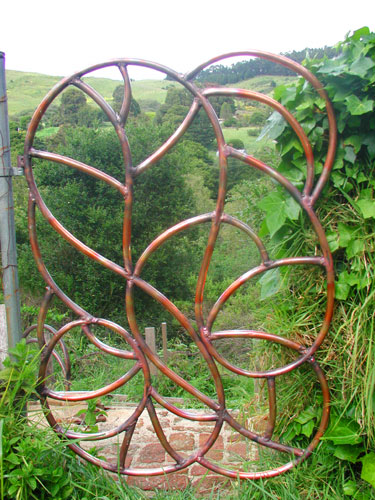 Copper garden gate kenneth griswa copper artist for Welded garden art designs